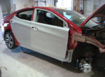 Photographs of a 2014 Hyundai automobile that was in an accident and repaired by Elite Paint & Body Shop in West Palm Beach Florida