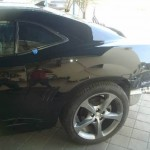 Photographs of a 2014 Chevrolet Camaro that was in an accident and repaired by Elite Paint & Body Shop in West Palm Beach Florida