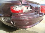 Photographs of a 1996 Chevrolet Impala SS that was damaged in an accident and repaired by Elite Paint & Body Shop in West Palm Beach Florida