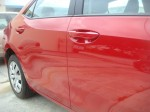 Photographs of a damaged red Toyota Corolla that was repaired by Elite Paint & Body Shop in West Palm Beach Florida