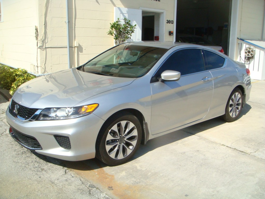 Before and after photographs of a damaged, silver, Honda Accord that was repaired by Elite Paint & Body Shop in West Palm Beach, FL.