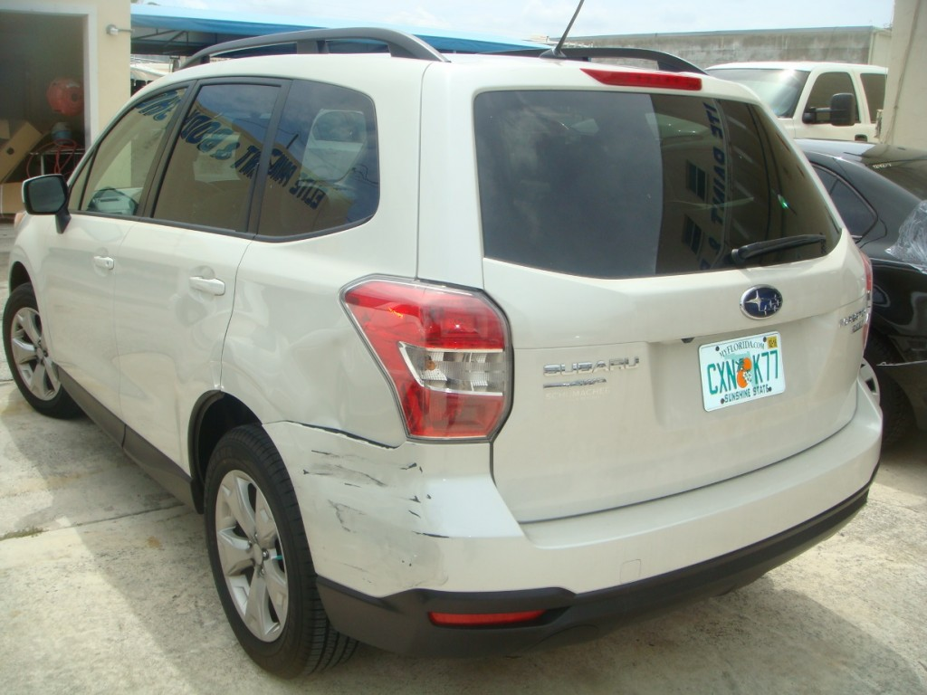 Photographs of a damaged white Subaru that was repaired by Elite Paint & Body Shop in West Palm Beach Florida